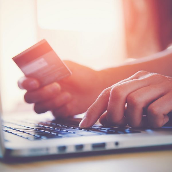 photo of man making payment by credit card