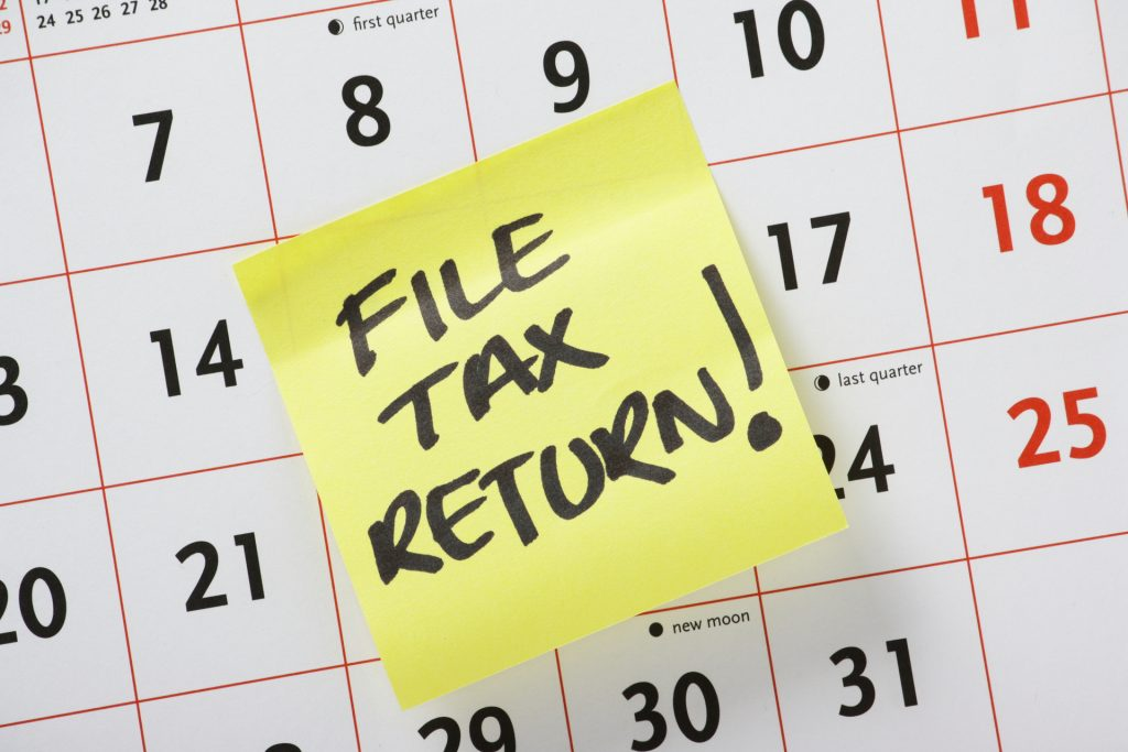Calendar with File Tax Return post it note