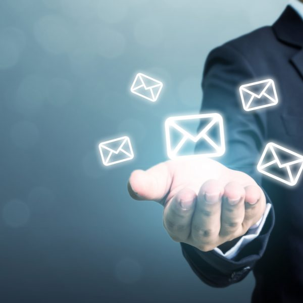 Man holding email icons