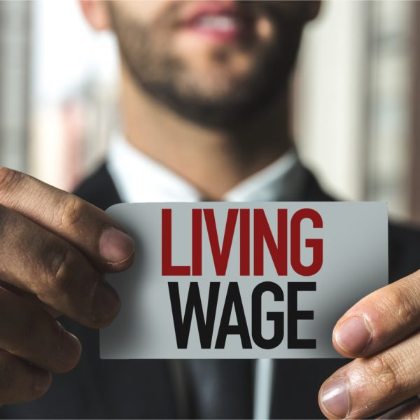 Man holding sign saying Living Wage
